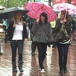 Shoppers in rain