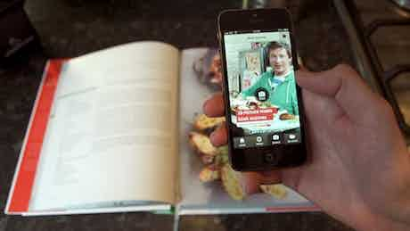 Jamie Oliver adopts augmented reality to enhance traditional cookbook.