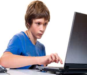 Teenager on computer