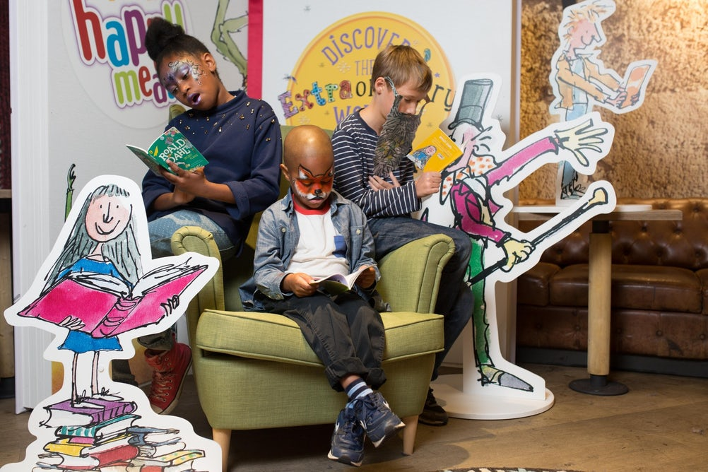EDITORIAL USE ONLY L-R Georgia Pachoo 9, Noah Panchoo 5 from Greenwich and Nick Stewart-Smith 10 from Clapham getting stuck in to reading eight specially created new Roald Dahl books, featuring extracts from Roald Dahl's most popular stories, launching as part of the latest McDonald's Happy Readers campaign. PRESS ASSOCIATION Photo. Picture date: Saturday September 19, 2015. Over the next six weeks, 14 million books will be distributed as part of McDonald's Happy Meals, making the extraordinary world of Roald Dahl accessible to millions of children. Photo credit should read: David Parry/PA Wire