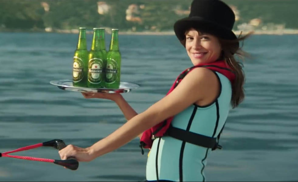 Heineken's ad to promote the latest James Bond film Spectre aims to promote more diversity and sees Bond saved by a woman.