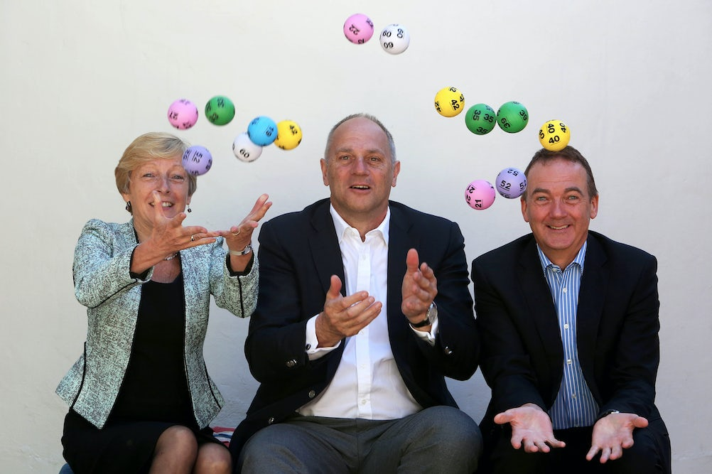 (Left to right) Liz Nicholl, CEO of UK Sport, Sir Steve Redgrave and Andy Duncan, Camelot CEO. Credit: Geoff Caddick/PA Wire
