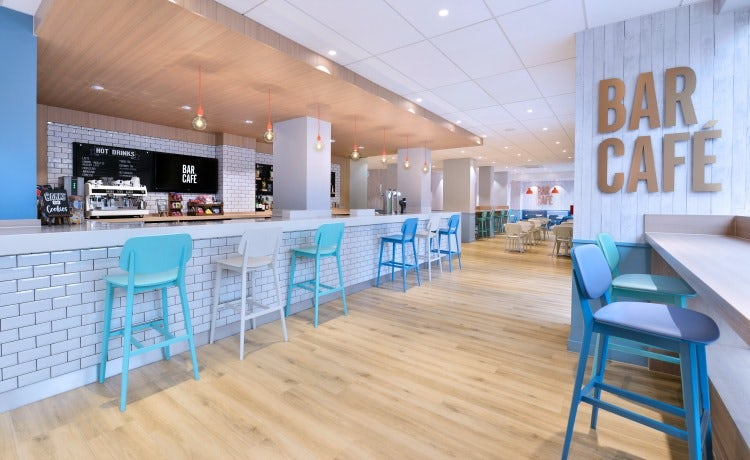 Travelodge admits price alone cannot boost loyalty as it launches travelodges new bar design includes high tables to work at and more usb ports colourmoves